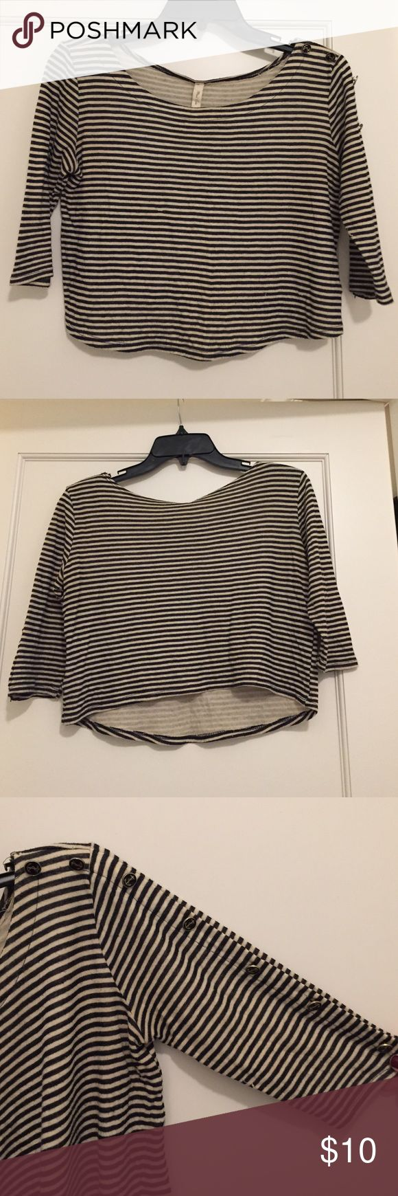 Striped crop top with buttons Cream and black striped crop top with anchor buttons down left sleeve. Super soft, loose fitting Tops Crop Tops