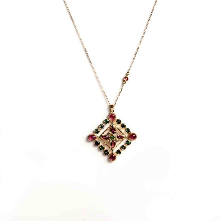 Hania Kuzbari Arabesque Collection pendant of 18K yellow gold, brown diamond, pink and green tourmaline // http://haniakuzbari.com/arabesque.php