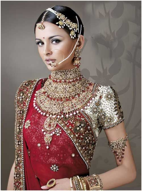 Heavy Kundan jewellery with simple face make up  adds grace to this Rajasthani Bride