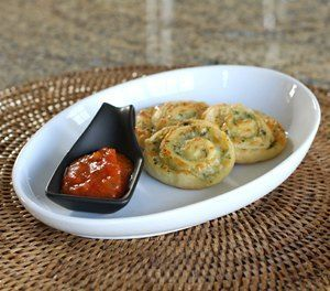 A simple 3-ingredient appetizer made with crescent roll dough, prepared pesto, and mozzarella cheese. Serve these simple pinwheels warm for a delicious little snack - they're great with wine!