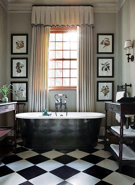 Black and white floors, framed botanicals, curtains, sconce, tub - John Jacob Interiors