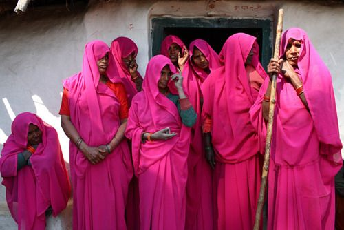 """Fed up with abusive husbands and corrupt officials, India's poorest women are banding together, taking up arms, and fighting back. Even more shocking than the pink saris they wear: Their quest for justice is actually working. In one of the most backward regions of India, the badlands of Central India, village women dressed in pink saris are getting togther to fight corruption and injustice and to raise their voices against the system.""""Pink Gang"""" fights for the rights of women and other…"""
