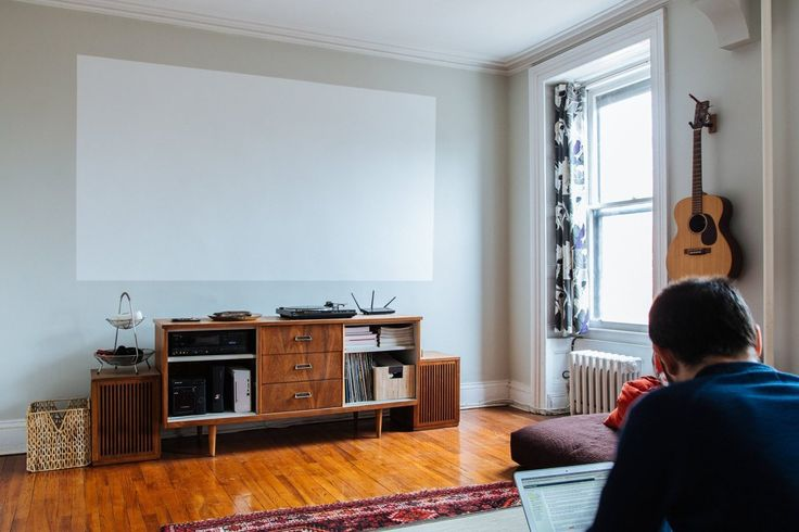 """That is a painted """"screen"""" for a projector. So cool. Adam & Ellen's Inspired Brooklyn Brownstone"""