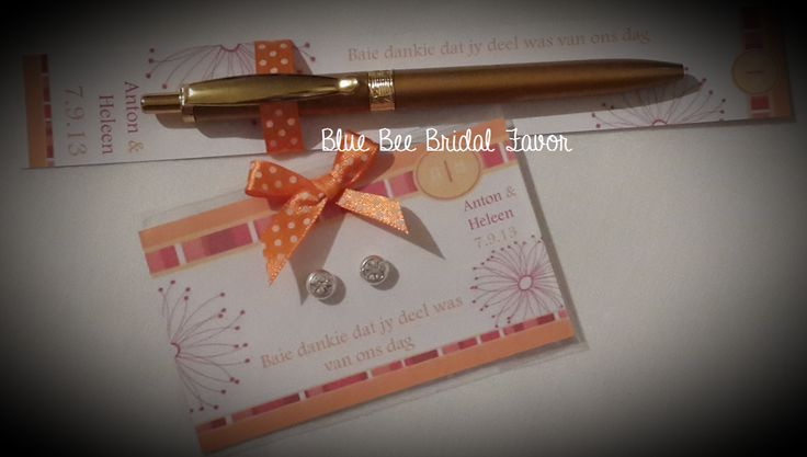 Wedding favor set.  Personalized card with a pen for the gents and magnetic earrings for the ladies.  Magnetic earrings are so much more hygienic and easy to apply.  No piercings required