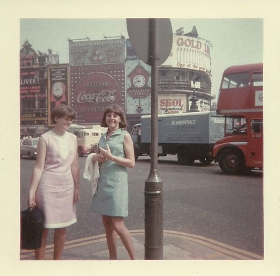 Piccadilly Circus, London, 1961 found photo street style vintage fashion early 60s shift dress pink blue day summer casual women