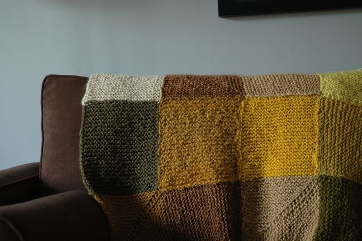 """A blanket knit entirely from wool dyed with things found in our backyard. Dandelion (ahem!), stinging nettle, marigold, goldenrod, rhubarb leaves, and onion skins gave various shades of yellow. Brown-eyed Susans and False Indigo gave shades of green and black walnut hulls gave a beautiful brown."""