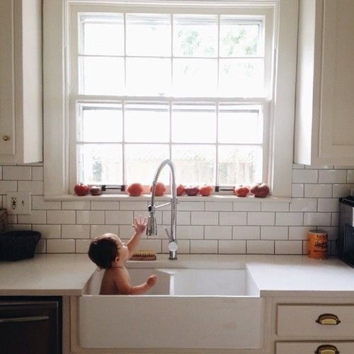 Want this! A beautiful functional kitchen, where a baby could easily fit in the sink.