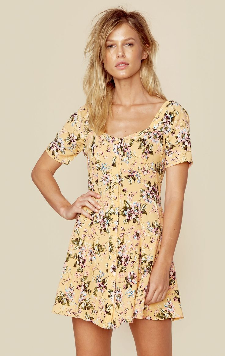 This fun and flirty number is Flynn Skye's Nyla Mini Dress. Featuring a floral print throughout, a fit and flare silhouette, button closure along the front, and a flowy crepe rayon fabrication. Made i