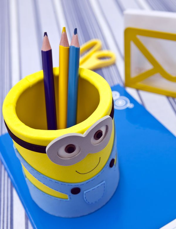 DIY minion pencil holder. Made from a tin can covered in foam and decorated. Too cute for a party craft