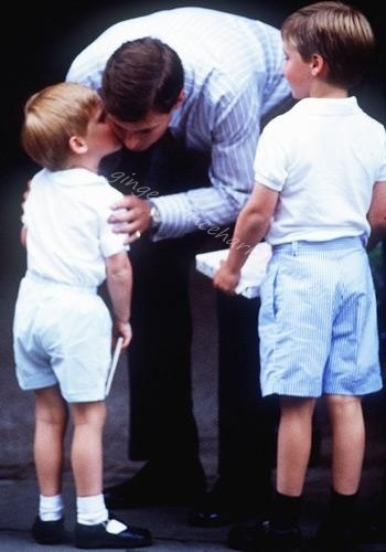 Prince Andrew, Duke of York greets his nephews Prince William and Harry with a kiss when they arrive at a hospital following the birth of Princess Beatrice August 11, 1988.
