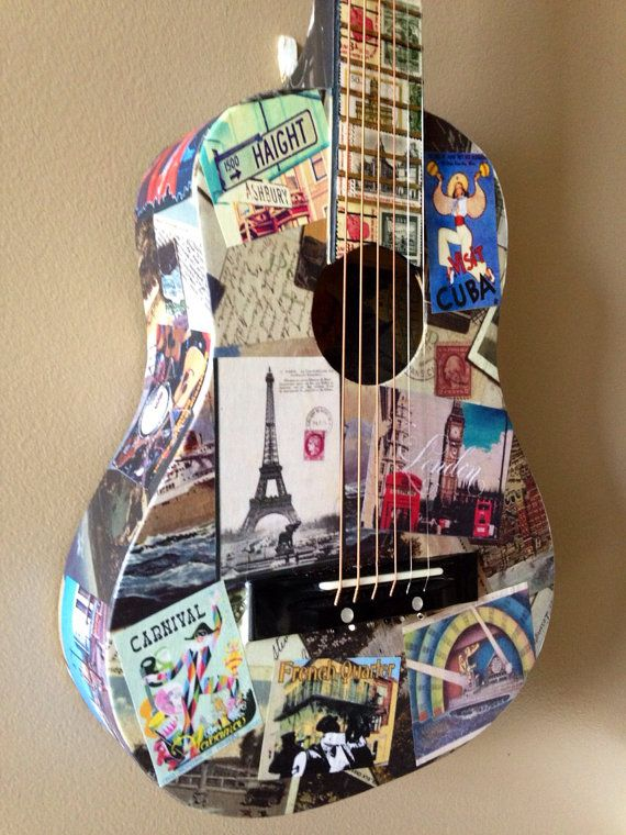 """Playable art called, """"The Traveling Guitar"""". It features images of """"the it"""" cities for music and vintage postcards of other famous cities around the world. The neck features vintage postage stamps from around the world."""