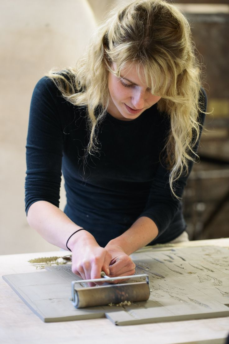 Hannah creates each and every tile by hand, pressing and cutting the clay using special tools.