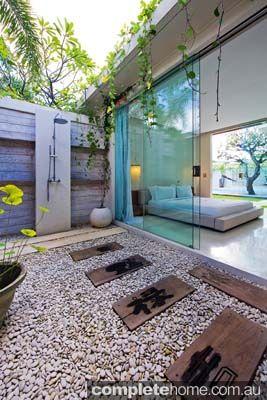 An outdoor shower in a luxury resort