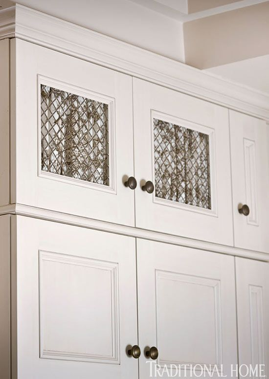 Cabinet Doors With Mesh Inserts And Toile Curtains In Kitchen With Brown  And Cream Fabrics