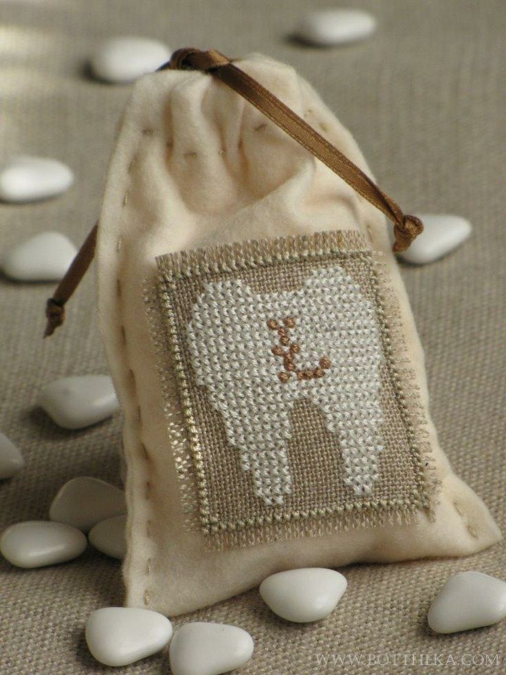 Little milk tooth bag cross stitch FREE http://bottheka.com/en/little-milk-tooth