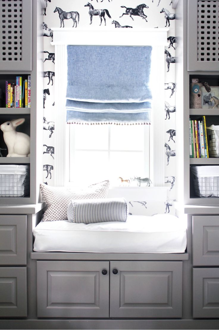 Nice built ins. Love the horse wallpaper and the pom pom trim. From Wit & Delight.