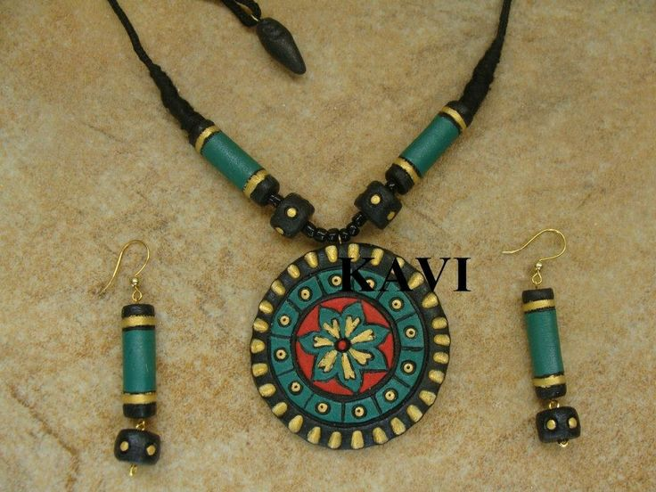 Beautiful handmade flower design terracotta jewelry painted on green , red & gold https://www.facebook.com/KavisTerracottajewellery