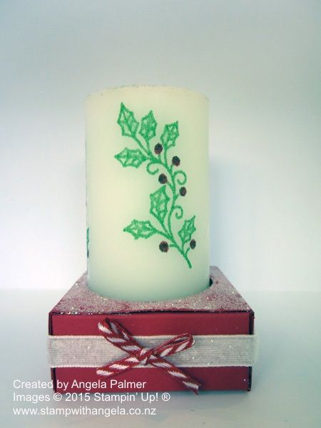 A candle stamped with the Embellished Ornaments stamp set and a box made for it to stand in.