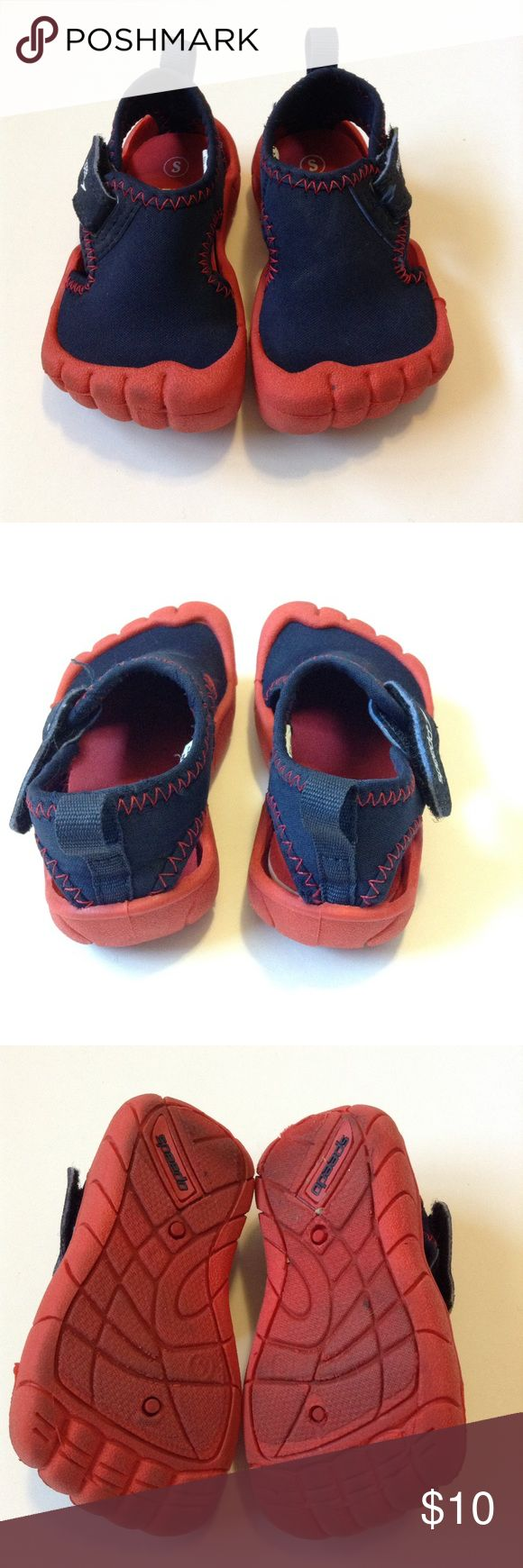 4 - Little Boy Speedo Water Shoes Cute little boy speedo water shoes. Neoprene upper, and rubber sole. Size small, but fit our little guy when he was size 3-4 shoes. Used but in great shape! Speedo Shoes Water Shoes