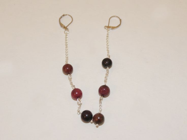 DIY Jewelry Hub's step-by-step instructions for making beaded gemstone chain earrings that dangle elegantly from your earlobes.