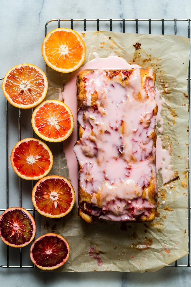 A citrus packed blood orange loaf cake topped with a tart blood orange icing. Serve a slice with a cup of your favorite tea!! via @foodnessg