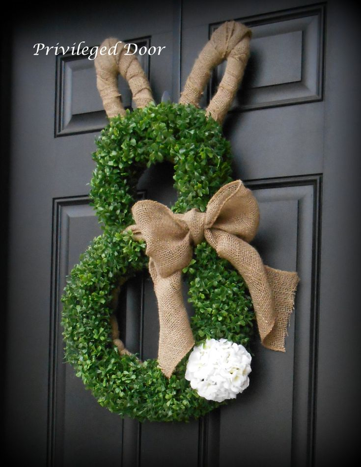 ~Faux Boxwood and Burlap Bunny Wreath with Geranium Tail ~ A complete Etsy original. TWO SIZES!  Thank you so much for visiting my shop! Im so thrilled you found this one of a kind design here! This custom designed wreath will make you so HOPPY this Easter!  It begins with an exclusive wooden bunny design that is woodworked in my studio and wrapped in burlap for the base. The darling is layered with lush, faux boxwood and the bunny is accented with a beautiful rustic burlap bowtie to match…