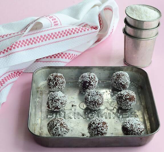Paleo Raw Chocolate Bites use leftover pulp from almond milk. Easy no-bake cookie recipe with only 5 ingredients --pulp, dates, cacao, coconut, and salt.