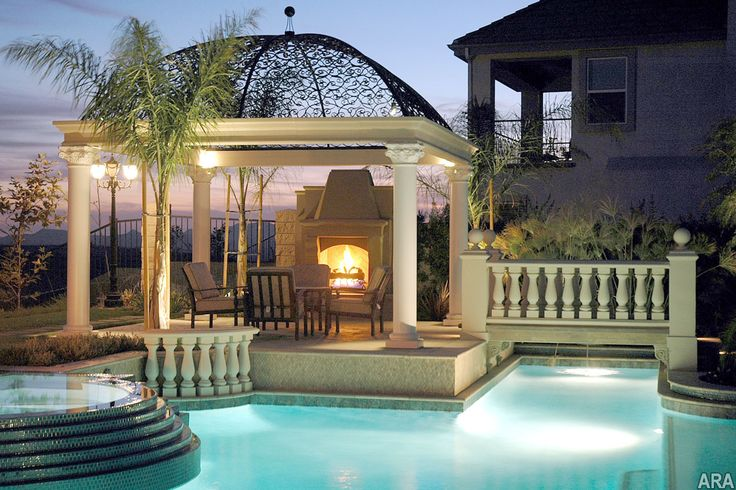 Beautiful and inviting pool side gazebo with outdoor fireplace and balustrade railings - Outdoor gazebo plans with fireplace ...