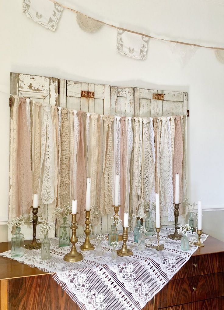 Vintage Amy Wedding Styling and Hiring Vintage candlesticks and vintage lace mixed with vintage bottles for whimsical wedding decor