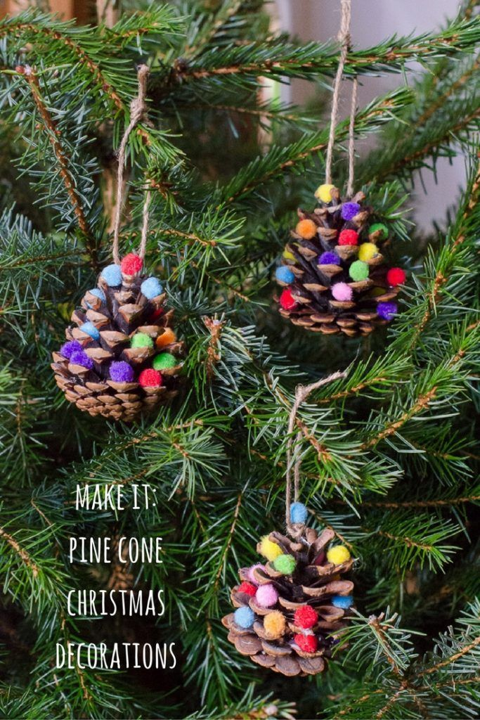 how to make natural homemade christmas decorations with pine cones and pom poms, a fun nature craft to get the kids involved in preparing your home for the holiday season.