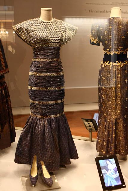 Designed for Queen Sirikit of thailand. (note the one at the back with the embellished jewel detail and filigree trim waistband). Both designed by Pierre Balmain