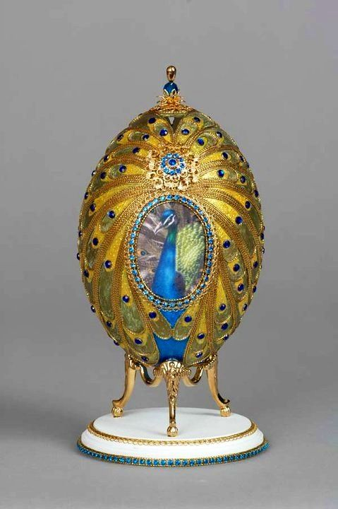 Amazing decorated gold peacock on egg. Looks like faberge.