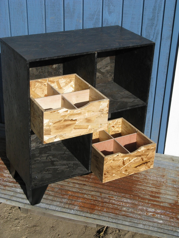 modular OSB cubby bookcase black stain with two cubby drawers. via Etsy.