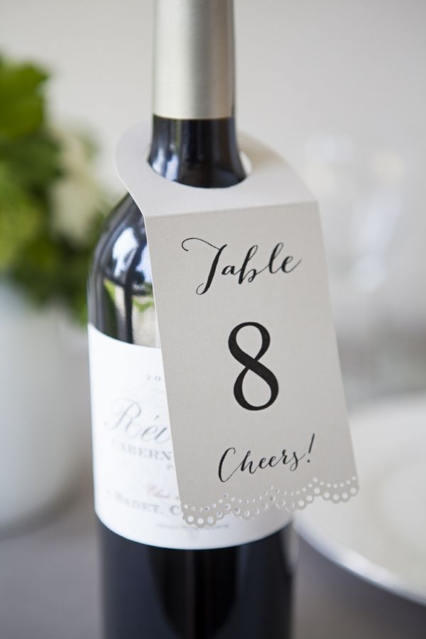 Love this easy but cute table number idea! | http://www.weddingpartyapp.com/blog/2014/10/23/5-easiest-diy-wedding-ideas/