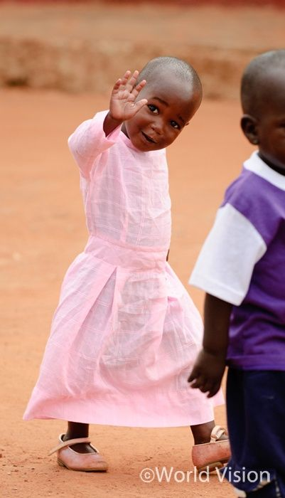 Back to school in Uganda!  I think this little girl may be the most precious thing ever - look at her face!!!  So beautiful!