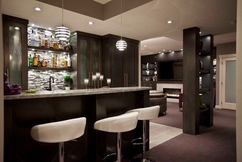 I've always wanted a bar in the basement.  This isn't my taste in cabintery, but I like the general layout of this particular basement.