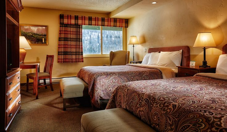 Mountain side with 2 queen beds. Each room is 360 square feet.