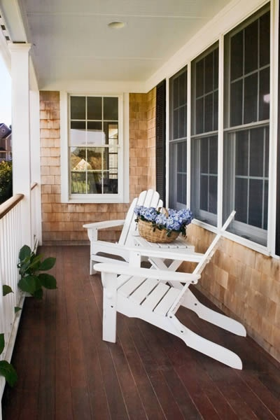 Narrow Porch With 2 Adirondack Chairs