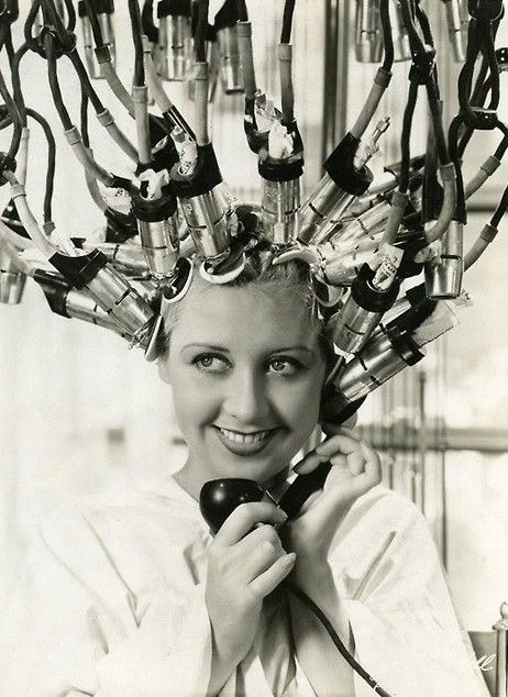 This is what it was like to get a permanent wave in the 1940s! (Joan Blondell)