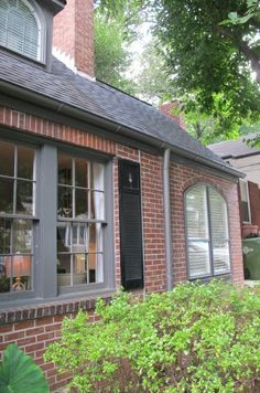 red brick, grey trim and black shutters.... but the real treat is the HOUSE STAGING
