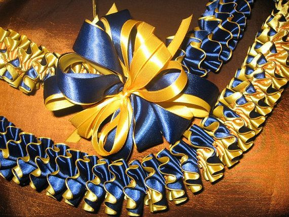 This gorgeous lei is constructed using 7/8 satin ribbon with 2 colors back to back. Can be made as classic plumeria with white/yellow or white/pink. Beautiful as a graduation lei with school colors...send me a message if youd like to discuss color choices. Great keepsake that can be worn over and over for luaus, parties, and celebrations! Finished lei will be approximately 42-44. Please allow 1 week for construction and I will mail out using USPS priority mail. Please if ...