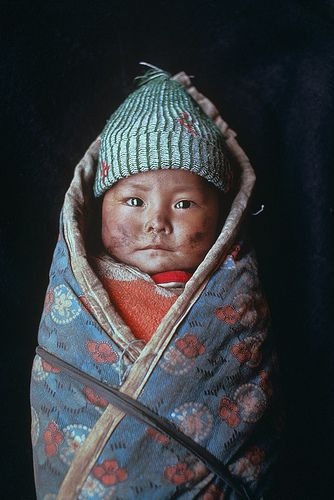 child wrapped in blanket, xigaze, tibet 1989