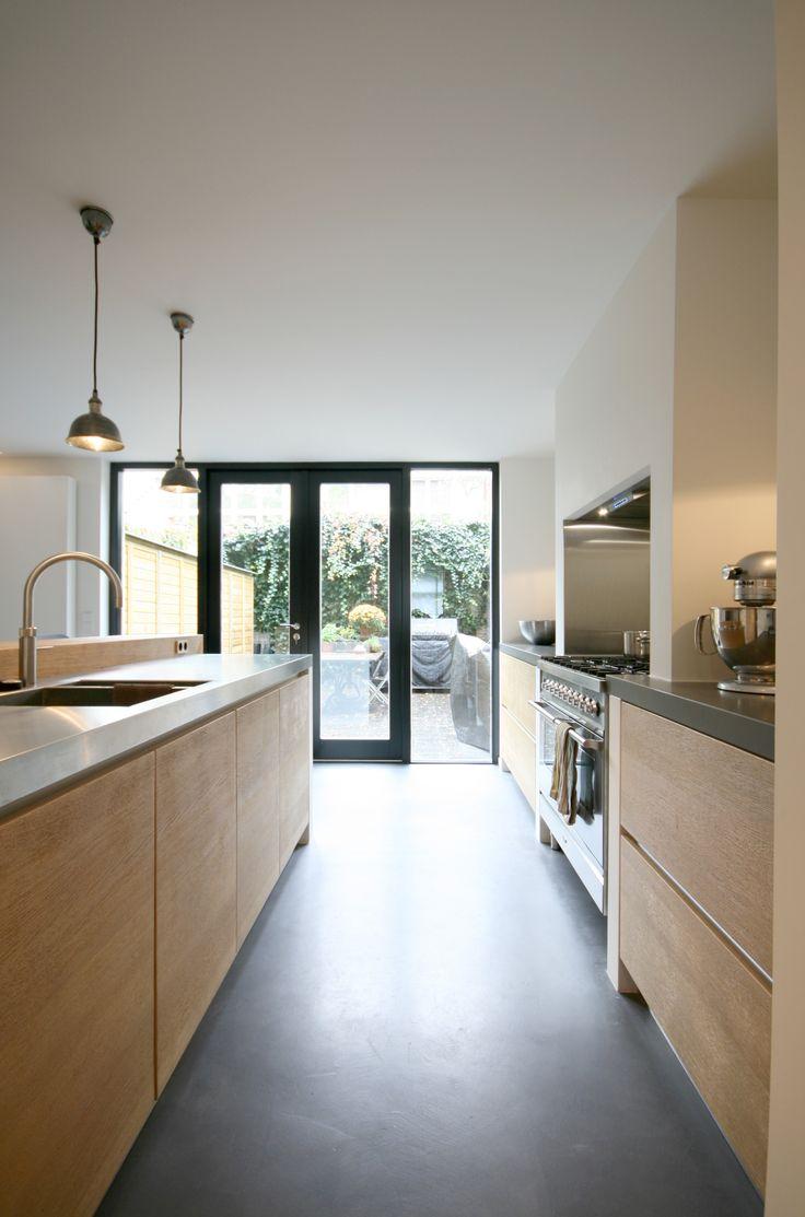 Kitchen.  Project summary: A complete makeover of a delapitated 19th century city house in the 'Zeehelden'-quarter in The Hague (NL). More information: http://www.foamarchitecten.nl/werk/50/woning-zeeheldenkwartier