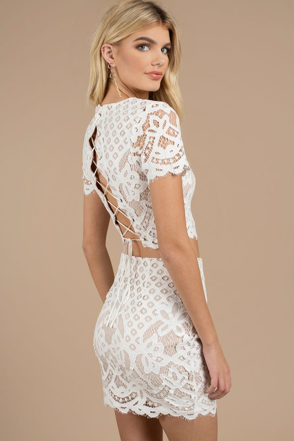 56f62657b0799 The Forever White Lace Crop Top designed by Tobi features a captivating lace  overlay with cap sleeves
