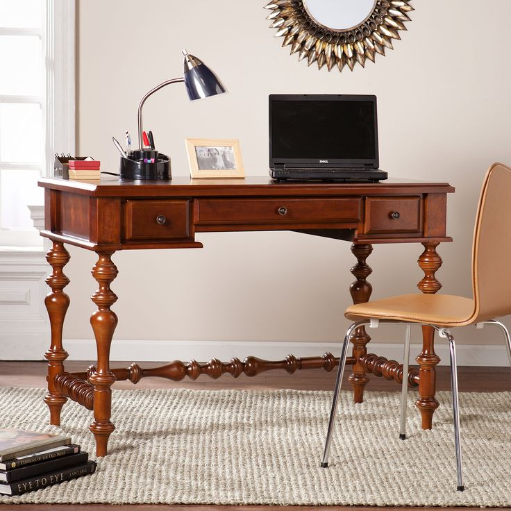 Southern Enterprises Huntleigh Writing Desk -. Farmhouse inspired traditional style. Elaborate turned legs. Two side drawers organize small office accessories and center fold-down drawer conceals a keyboard or laptop. Antique bronze finish. Transport workstation to the greenest of gables with this desk in a study, library, or home office.