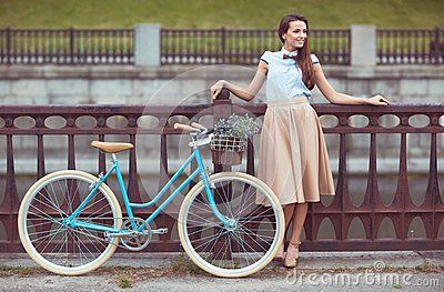 Young Beautiful, Elegantly Dressed Woman With Bicycle - Download From Over 50 Million High Quality Stock Photos, Images, Vectors. Sign up for FREE today. Image: 50593480