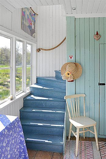 Beadboard, rope railing & the calm colors combine to make a comfortable beachy look.