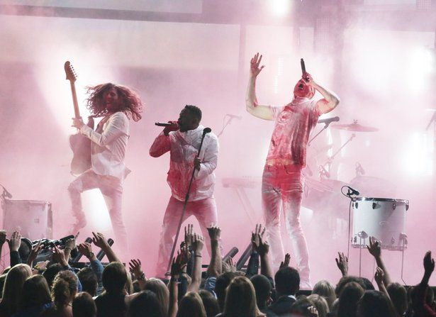 """In another one of the most anticipated collaborations, hip-hop artist Kendrick Lamar teams with alternative-rock band Imagine Dragons to perform a mash-up of songs """"Radioactive Teaser"""" / """"M.A.D.D. City"""" /""""Radioactive."""""""