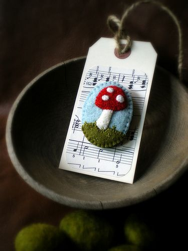 """Perhaps inspired by the amanita I found this past week, this little brooch popped into my head last night and I had to reach for the wool and thread.  Just 1.5"""" wide by 2"""" tall and made of felted wool sweater and coat material."""