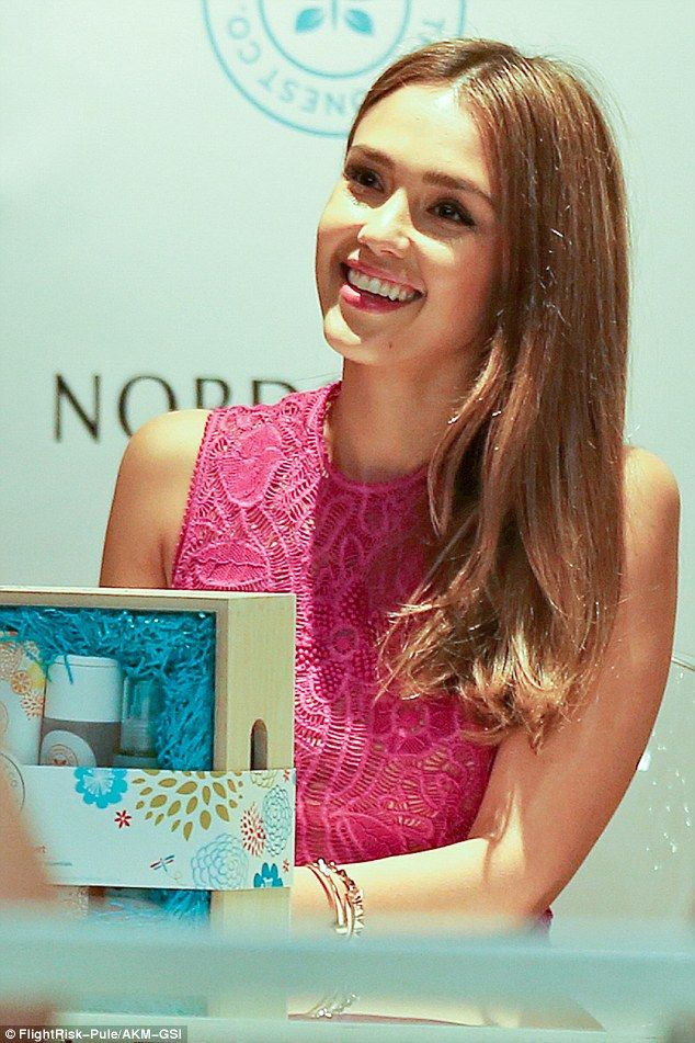 Natural beauty: Jessica Alba putting in some face-time with her loyal customers, as she made a promotional appearance in Hawaii, on Saturday.